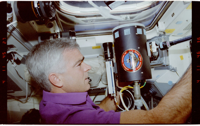 STS053-247-029 - STS-053 - Crewmember in aft FD with Battlefield Laser Acquisition Sensor Test
