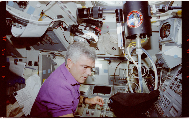 STS053-247-030 - STS-053 - Crewmember in aft FD with Battlefield Laser Acquisition Sensor Test