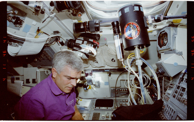 STS053-247-031 - STS-053 - Crewmember in aft flight deck (FD) with Battlefield Laser Acquisition Sensor Test.