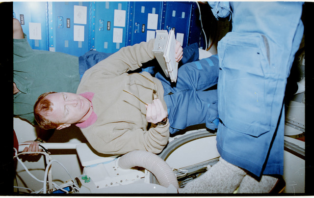 STS053-28-017 - STS-053 - Crewmember in the MDDK with the Radiation Monitoring Equipment III