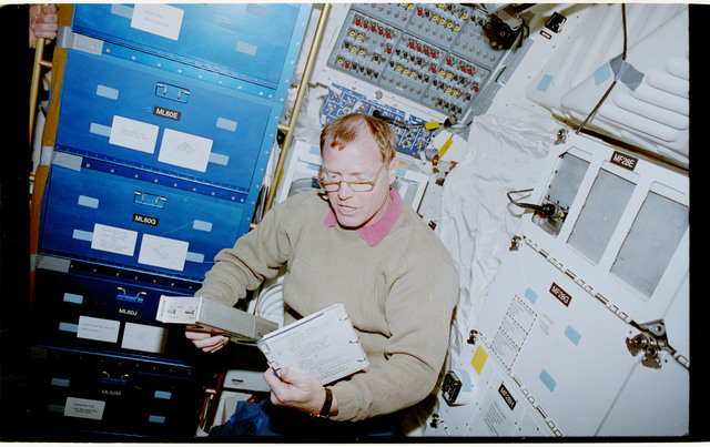 STS053-28-018 - STS-053 - Crewmember in the MDDK with the Radiation Monitoring Equipment III
