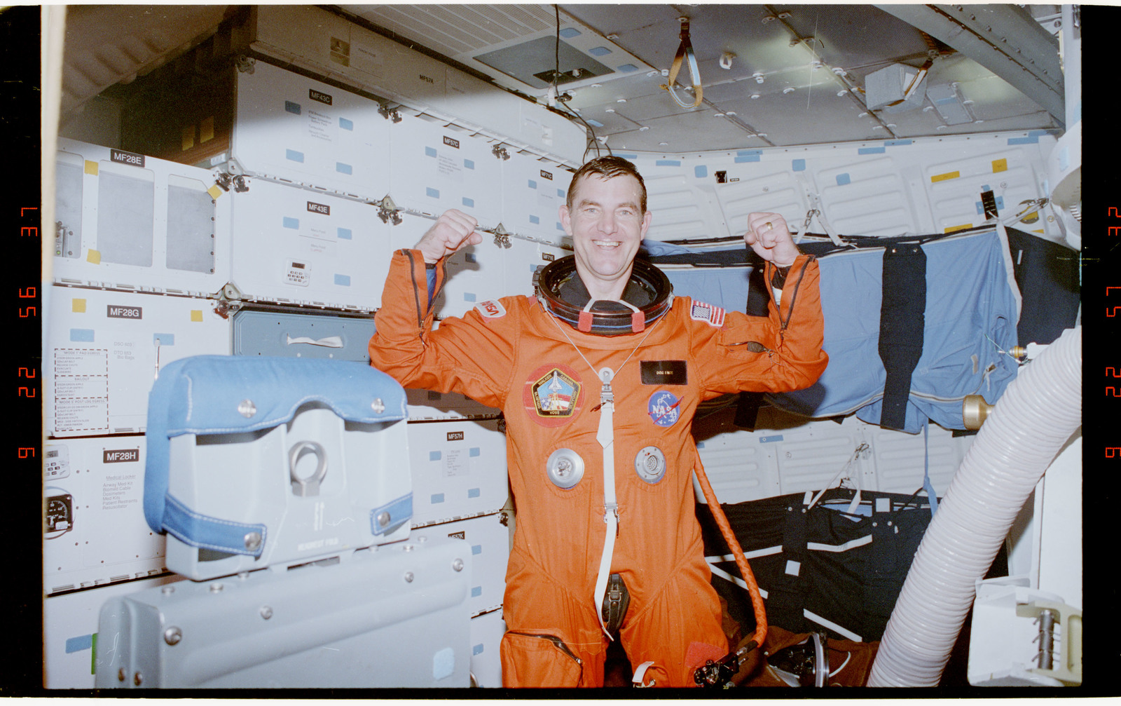 STS053-34-031 - STS-053 - Post landing view of launch entry suited crewmember in the middeck.