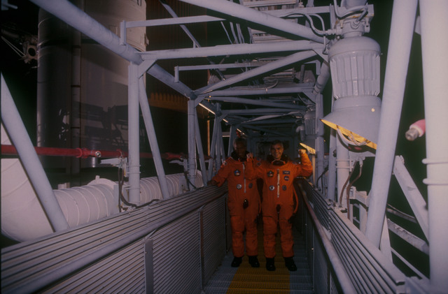 STS053-79-013 - STS-053 - KSC launch personnel on the swing arm gantry to the orbiter vehicle.
