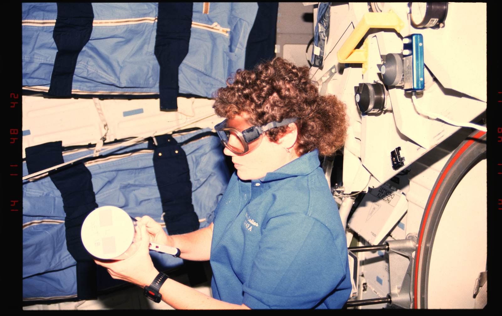 STS054-01-031 - STS-054 - Crewmember in the middeck with Commercial Generic Bioprocessing experiment.