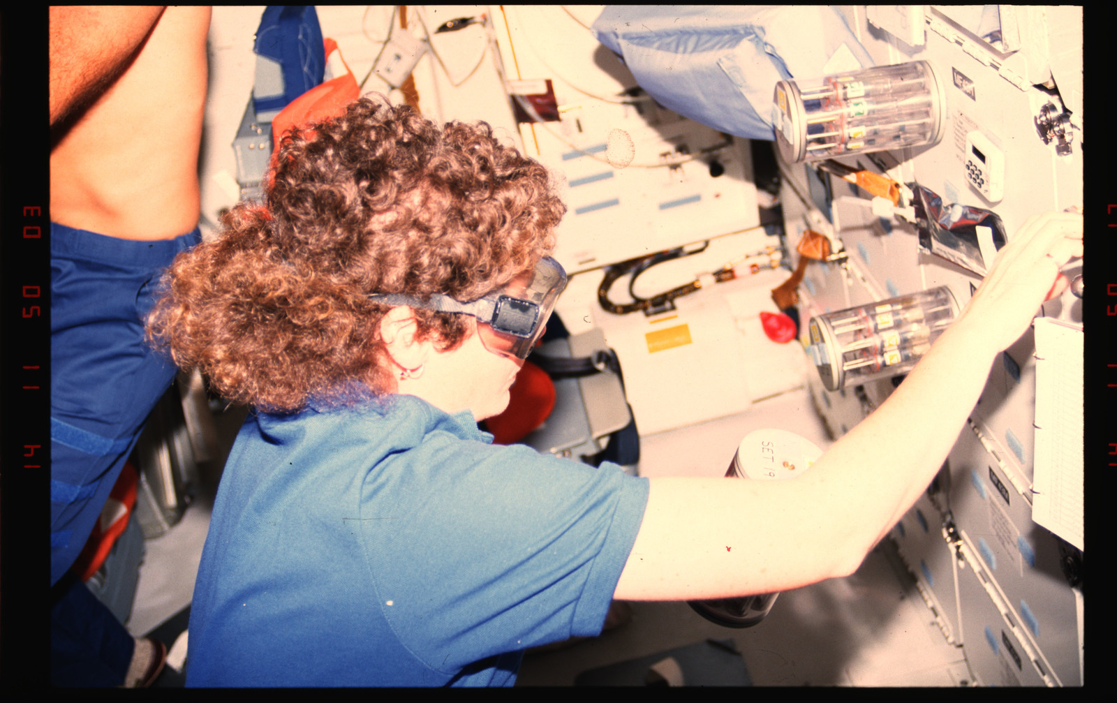 STS054-01-034 - STS-054 - Crewmember in the middeck with Commercial Generic Bioprocessing experiment.