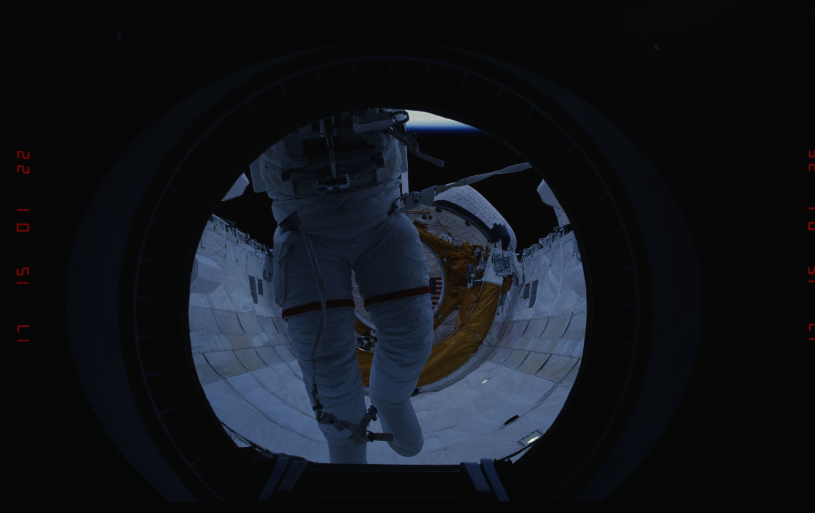 STS054-05-013 - STS-054 - Views of EVA Crewmembers in the payload bay returning to middeck air lock.