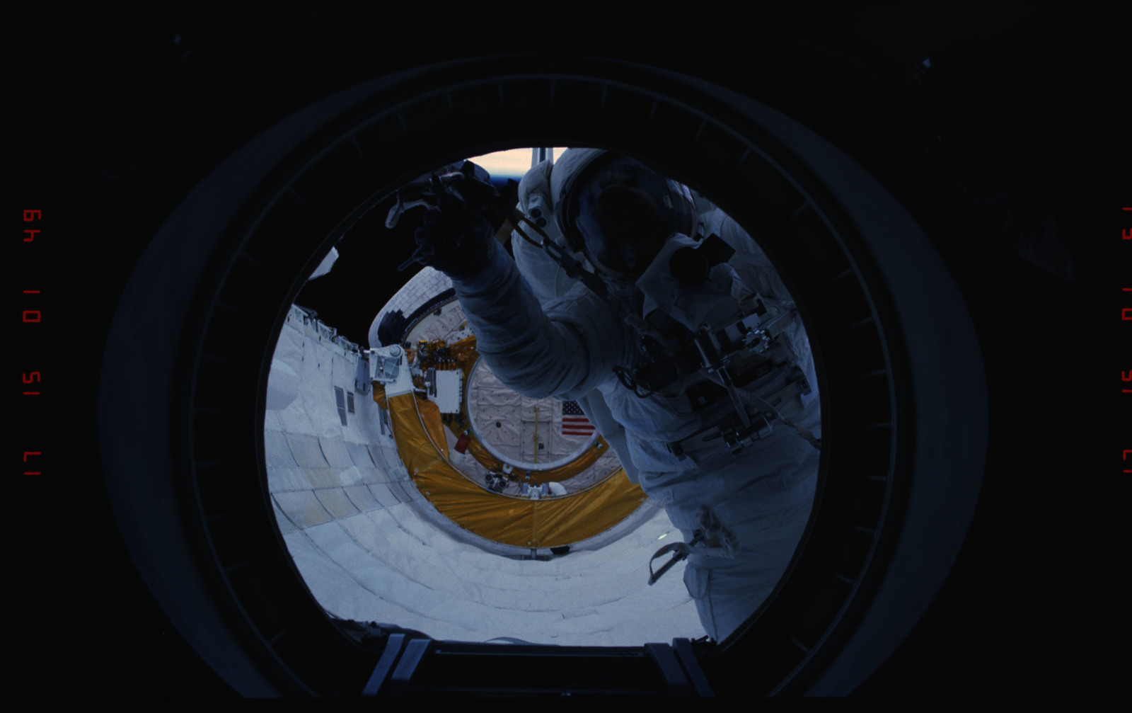 STS054-05-015 - STS-054 - Views of EVA Crewmembers in the payload bay returning to middeck air lock.