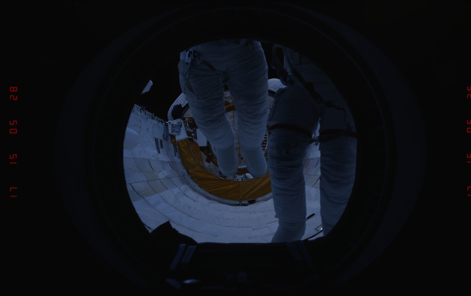 STS054-05-021 - STS-054 - Views of EVA Crewmembers in the payload bay returning to middeck air lock.