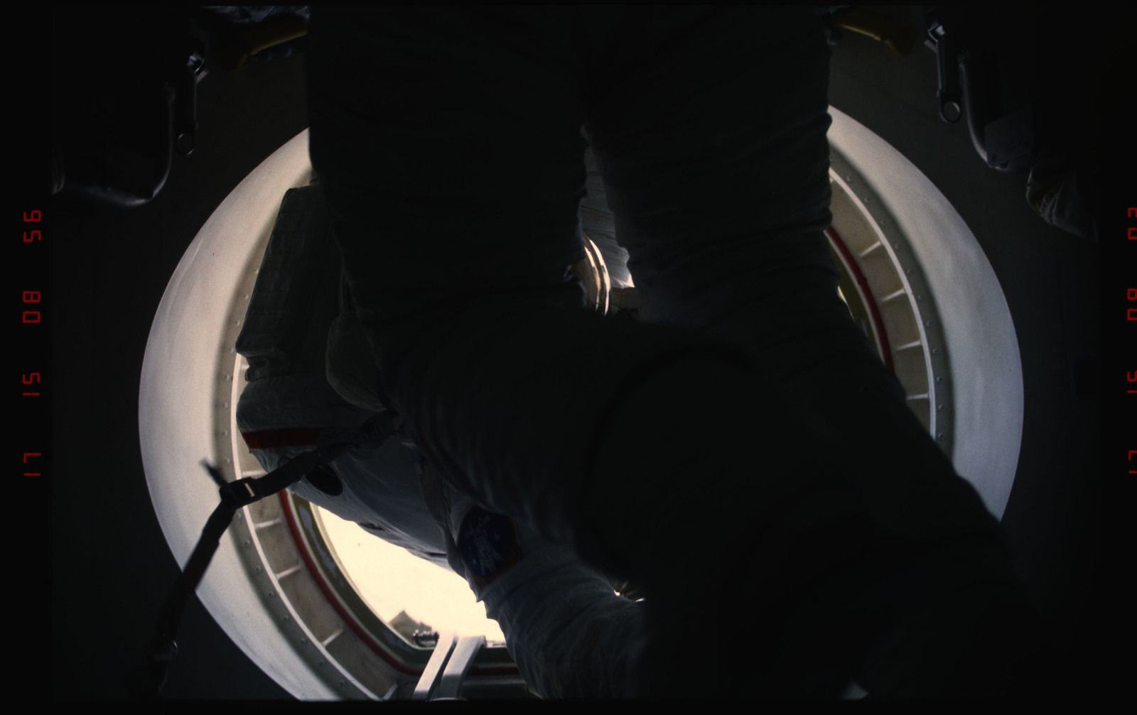 STS054-05-026 - STS-054 - Views of EVA Crewmembers in the payload bay returning to middeck air lock.