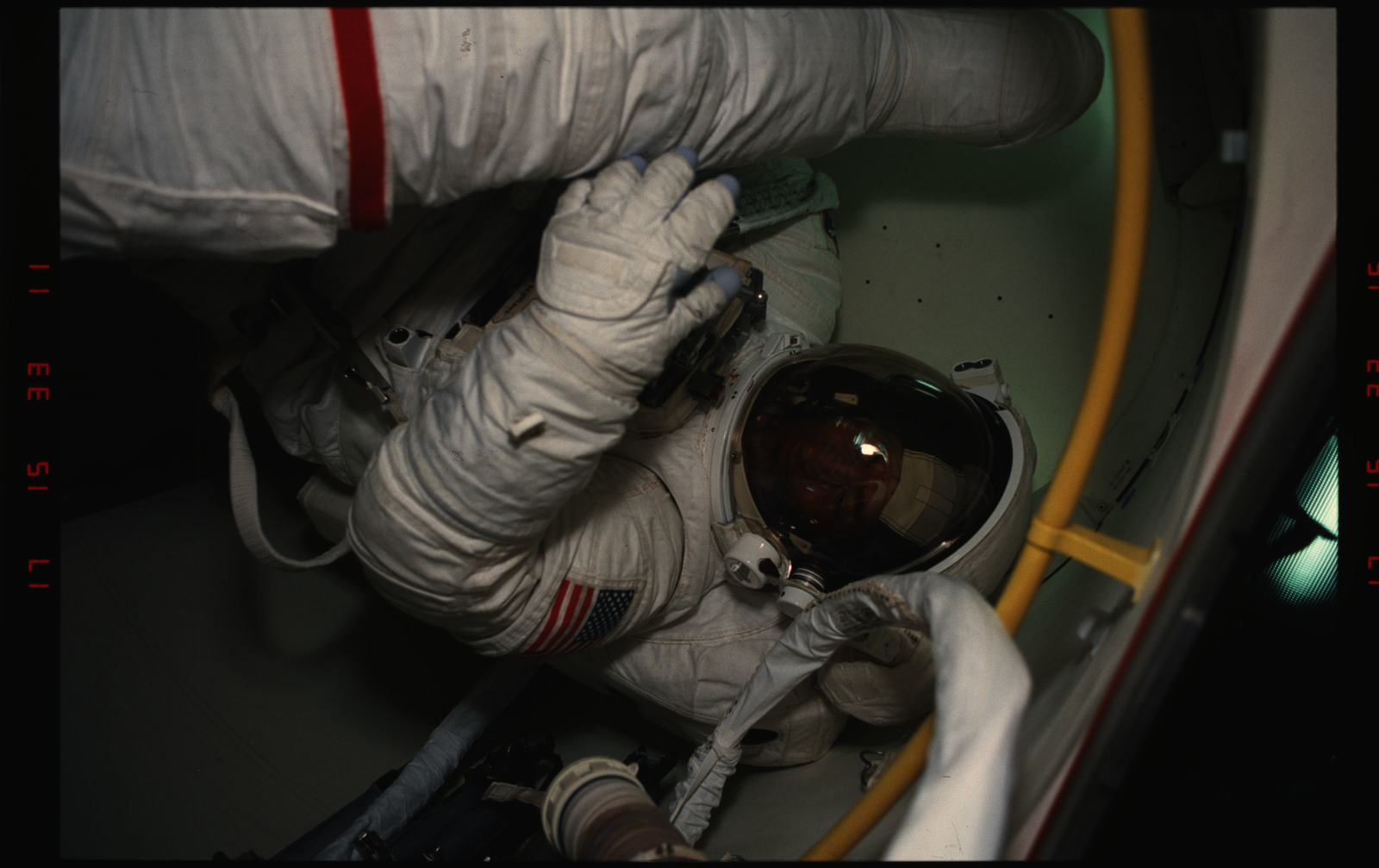 STS054-06-012 - STS-054 - EVA Crewmembers emerging from the air lock into the middeck.