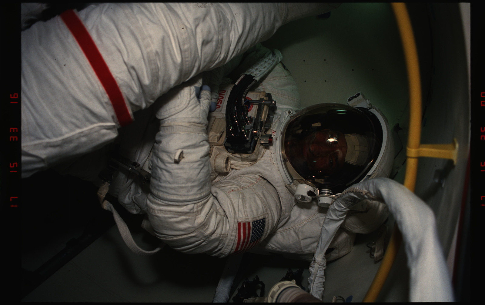 STS054-06-013 - STS-054 - EVA Crewmembers emerging from the air lock into the middeck.