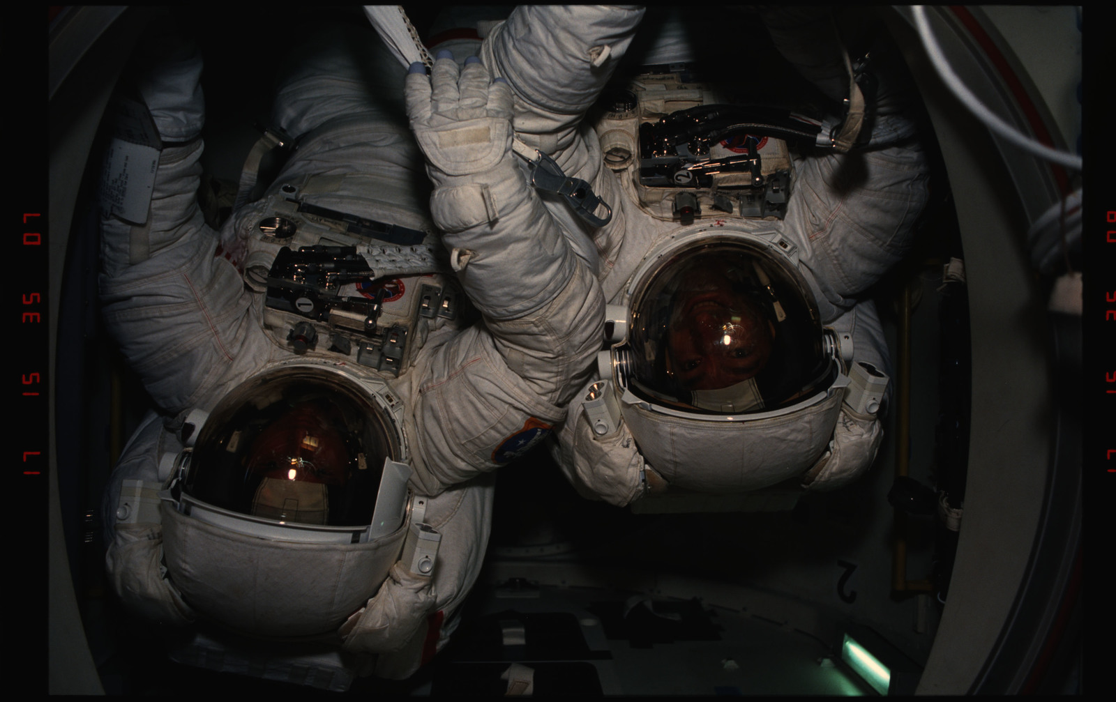 STS054-06-015 - STS-054 - EVA Crewmembers emerging from the air lock into the middeck.