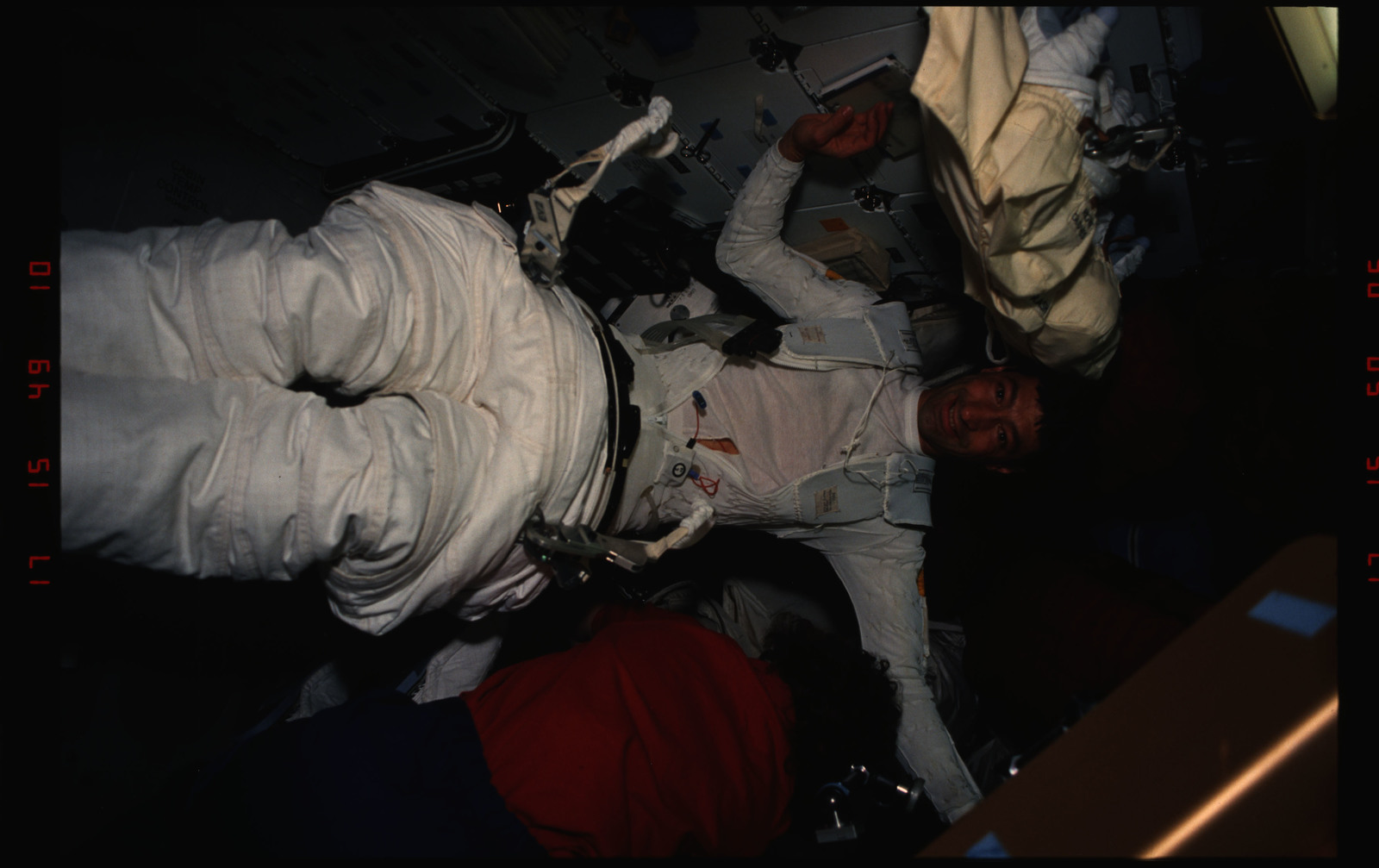 STS054-06-022 - STS-054 - EVA Crewmembers emerging from the air lock into the middeck.