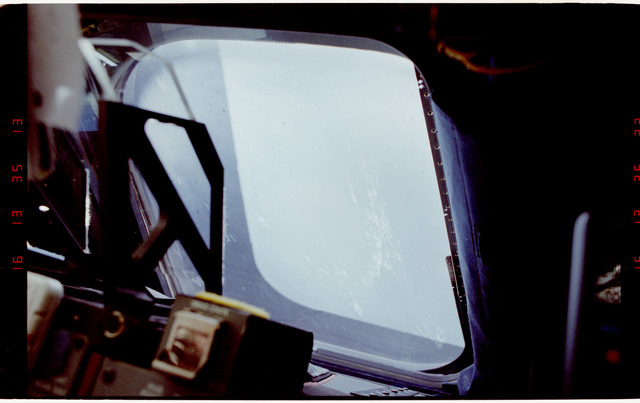STS054-16-022 - STS-054 - Views of scratches and liftoff debris on the forward windows.