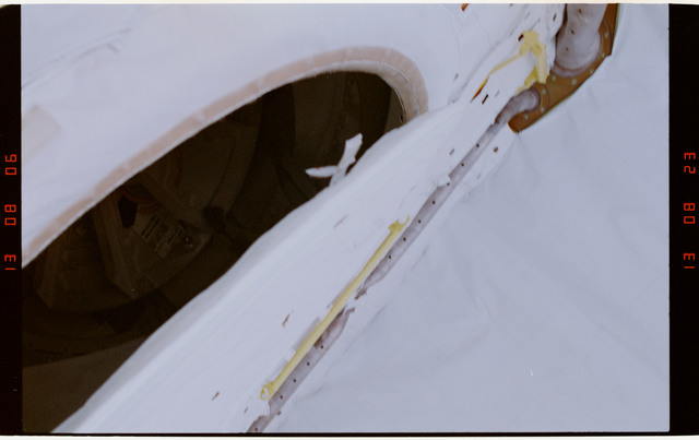 STS054-29-013 - STS-054 - Partial view of the exterior air lock hatch in the payload bay.
