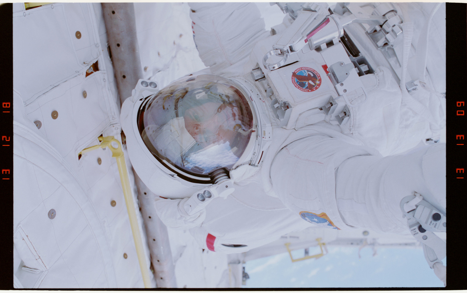 STS054-29-017 - STS-054 - Partial view of EV-1 (red stripe) crewmember in the payload bay.