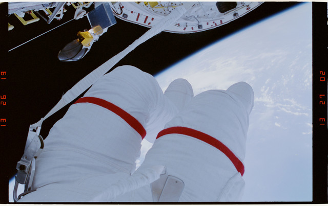 STS054-29-028 - STS-054 - Partial view of EV-1 (red stripe) Greg Harbaugh in the payload bay.