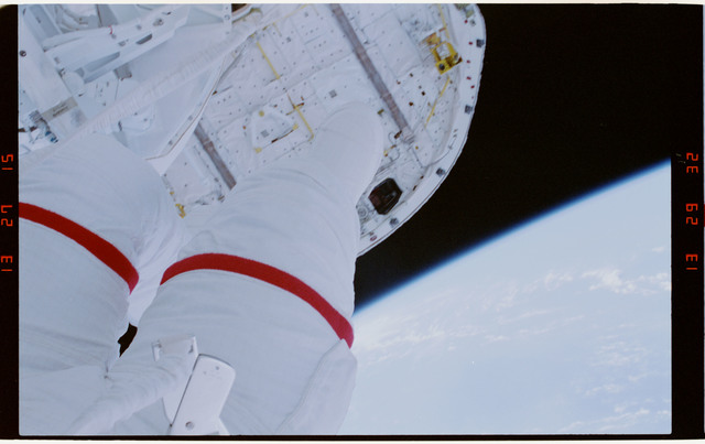 STS054-29-030 - STS-054 - Partial view of EV-1 (red stripe) Greg Harbaugh in the payload bay.