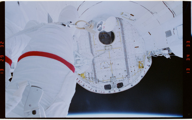 STS054-29-031 - STS-054 - Partial view of EV-1 (red stripe) Greg Harbaugh in the payload bay.