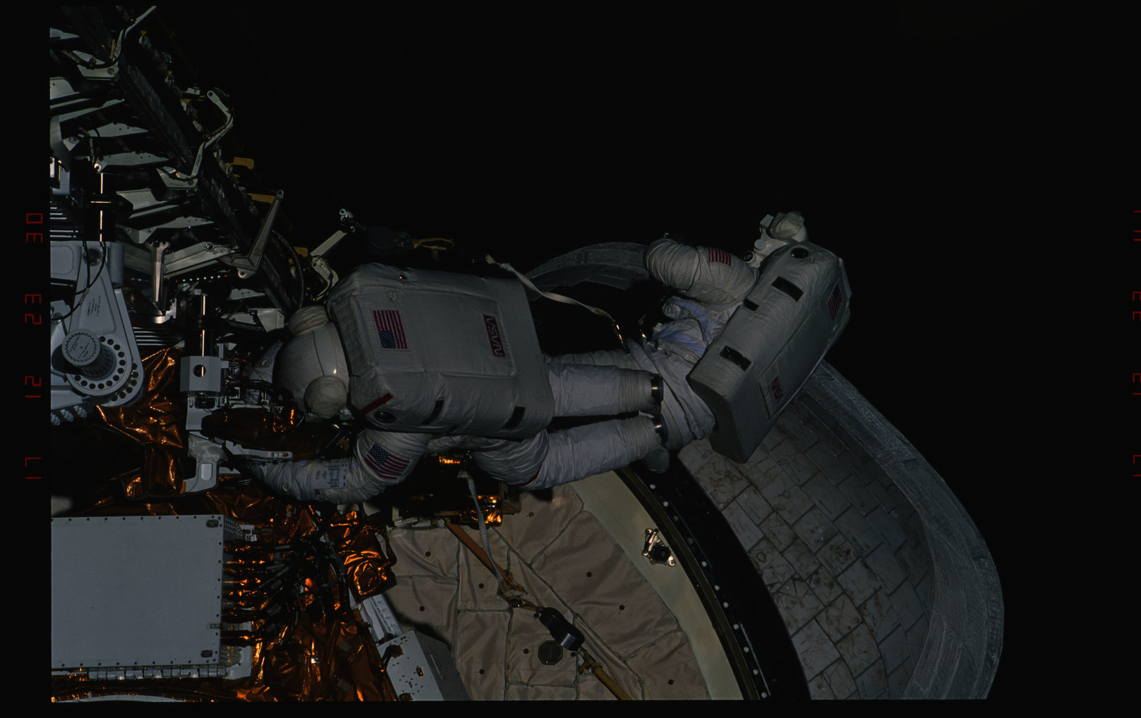 STS054-33-014 - STS-054 - Views of EVA Crewmembers working in the payload bay.