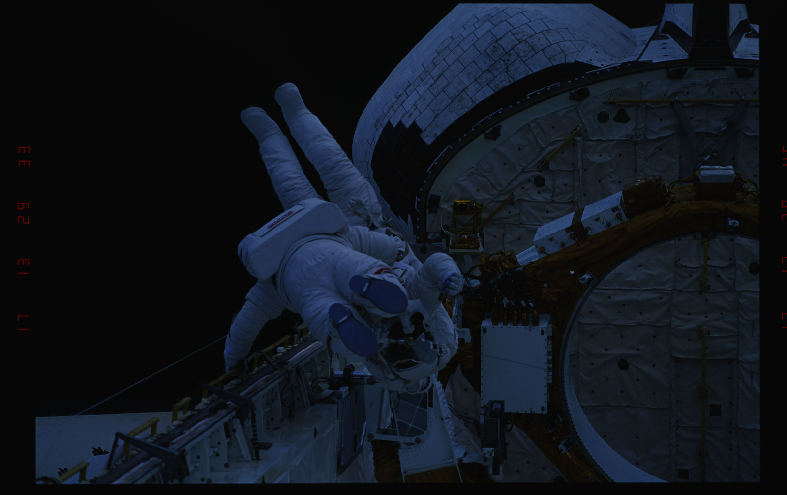 STS054-33-025 - STS-054 - Views of EVA Crewmembers working in the payload bay carrying one another.