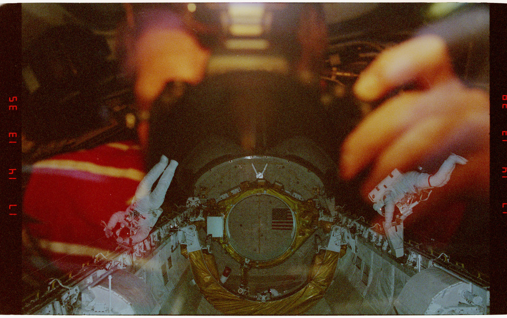 STS054-46-026 - STS-054 - Two crewmember EVA in the payload bay training with new tools and techniques.