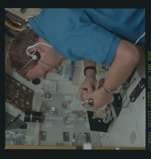 STS055-106-038 - STS-055 - STS-55 Payload Specialist Schlegel collects fungi sample at SL-D2 Rack 1