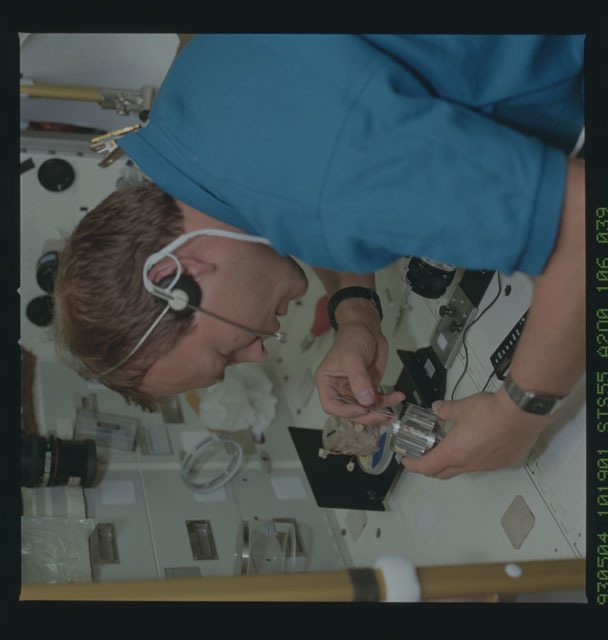 STS055-106-039 - STS-055 - STS-55 Payload Specialist Schlegel collects fungi sample at SL-D2 Rack 1