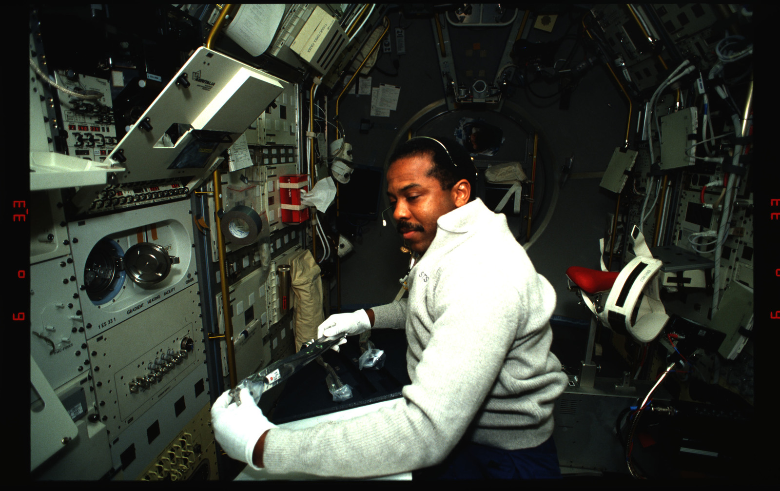 STS055-13-029 - STS-055 - Crewmember at Work in the Spacelab at the Material Sciences Laboratory