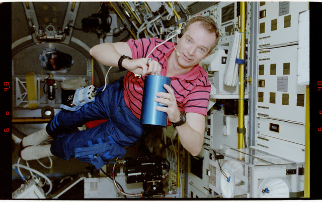 STS055-23-003 - STS-055 - Crewmember in the Middeck with Crew Compartment Air Sampler