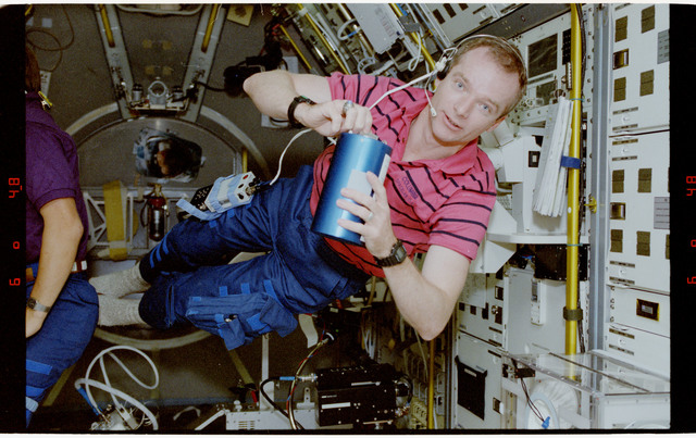 STS055-23-004 - STS-055 - Crewmember in the Middeck with Crew Compartment Air Sampler