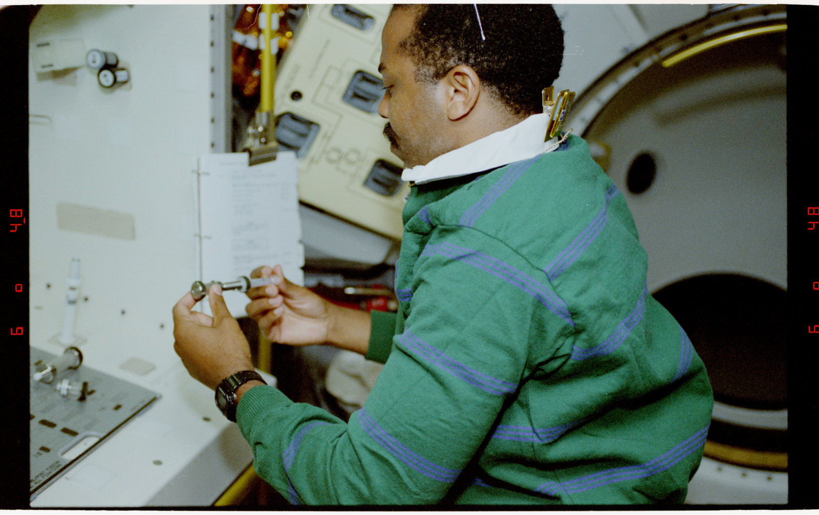 STS055-23-012 - STS-055 - Crewmember at Work Preparing Syringes in the D-2 Spacelab