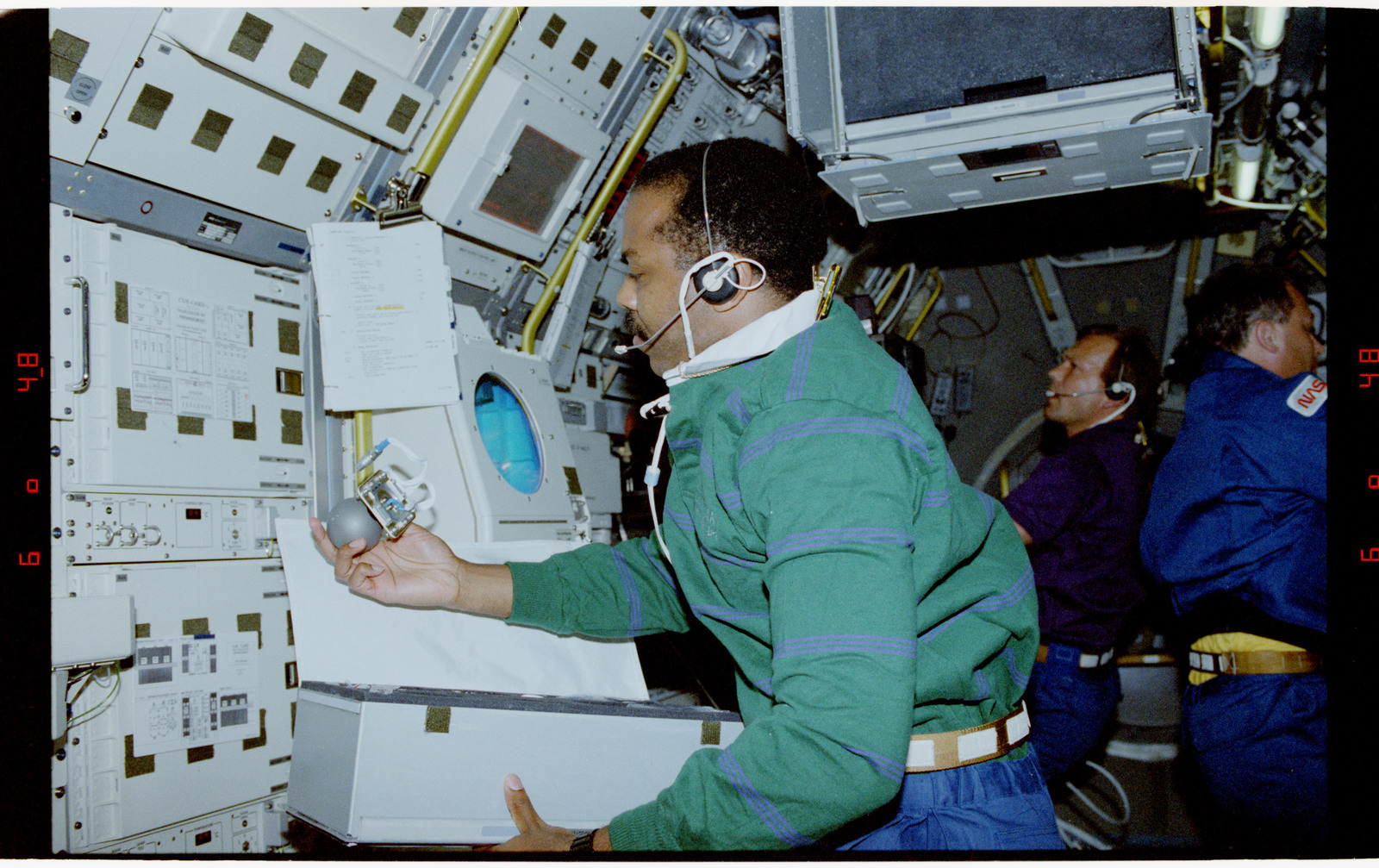 STS055-23-021 - STS-055 - Crewmember at Work in the D-2 Spacelab at the ROTEX Rack ``B``