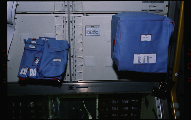 STS055-231-002 - STS-055 - Views of utility bags and sample containers at the D-2 Spacelab workstation.