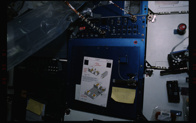STS055-231-022 - STS-055 - Inflight Maintenance View of an Improvised AIr Duct Made from Plastic Bags.
