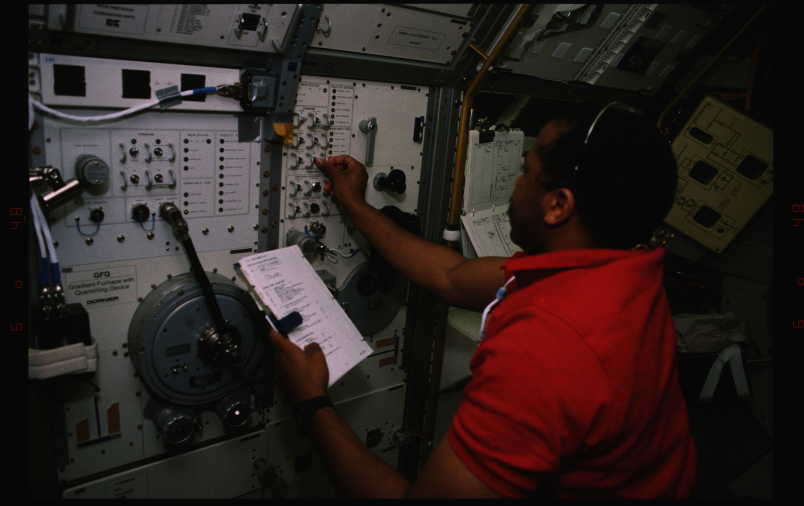 STS055-235-025 - STS-055 - Crewmember at the D-2 Spacelab MEDEA Rack Furnace.