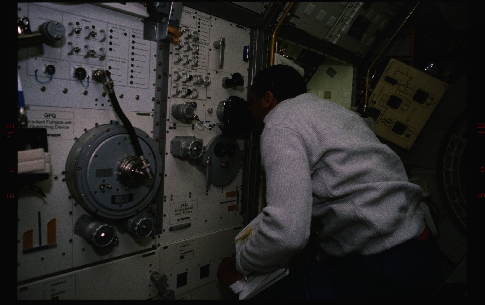 STS055-235-031 - STS-055 - Crewmember at the D-2 Spacelab MEDEA Rack Furnace.