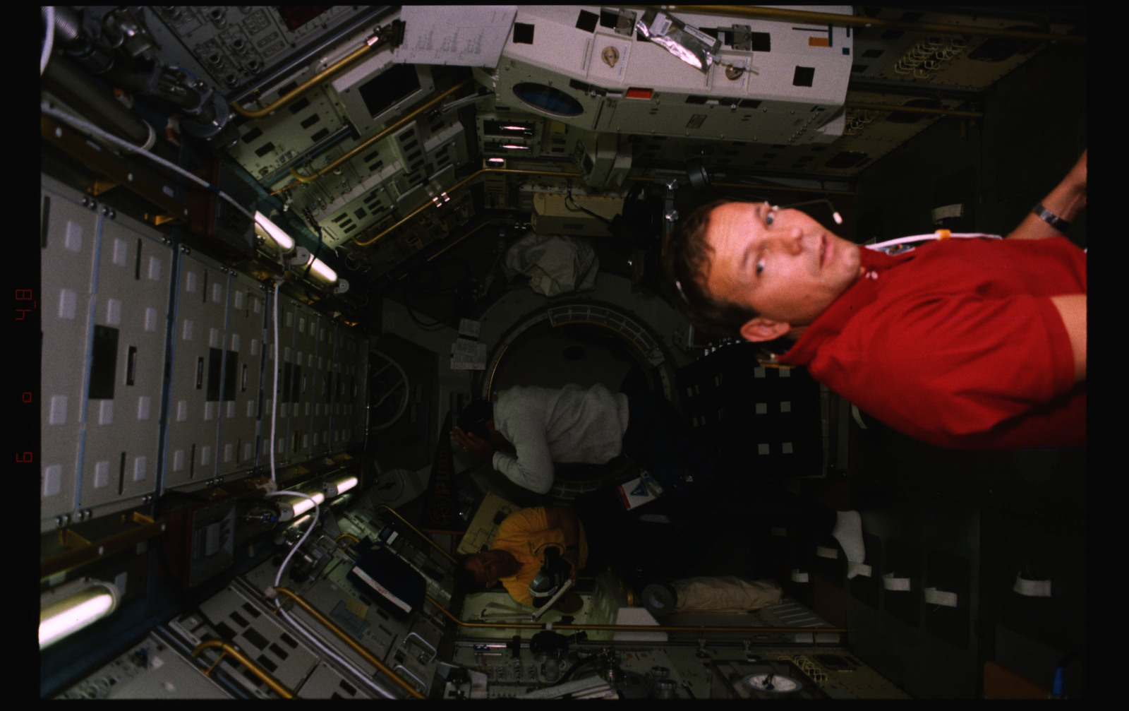 STS055-235-037 - STS-055 - Candid view of crewmembers at work in the D-2 Spacelab