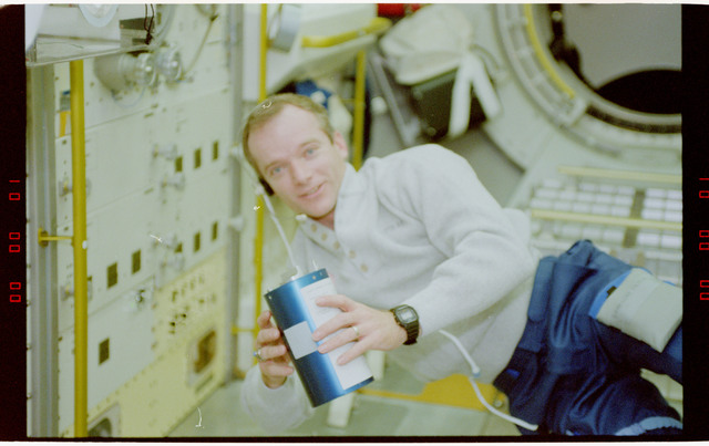 STS055-45-014 - STS-055 - Crewmember in the D-2 Spacelab with the Solid Sorbent Air Sampler.