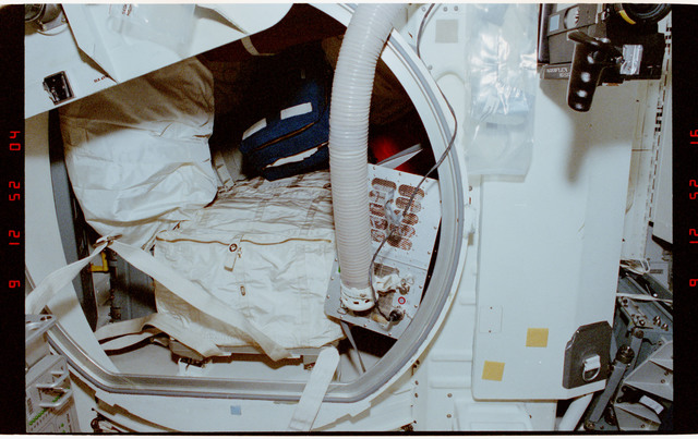 STS056-05-017 - STS-056 - Views of the flexible middeck air duct to cool an overheating power unit.