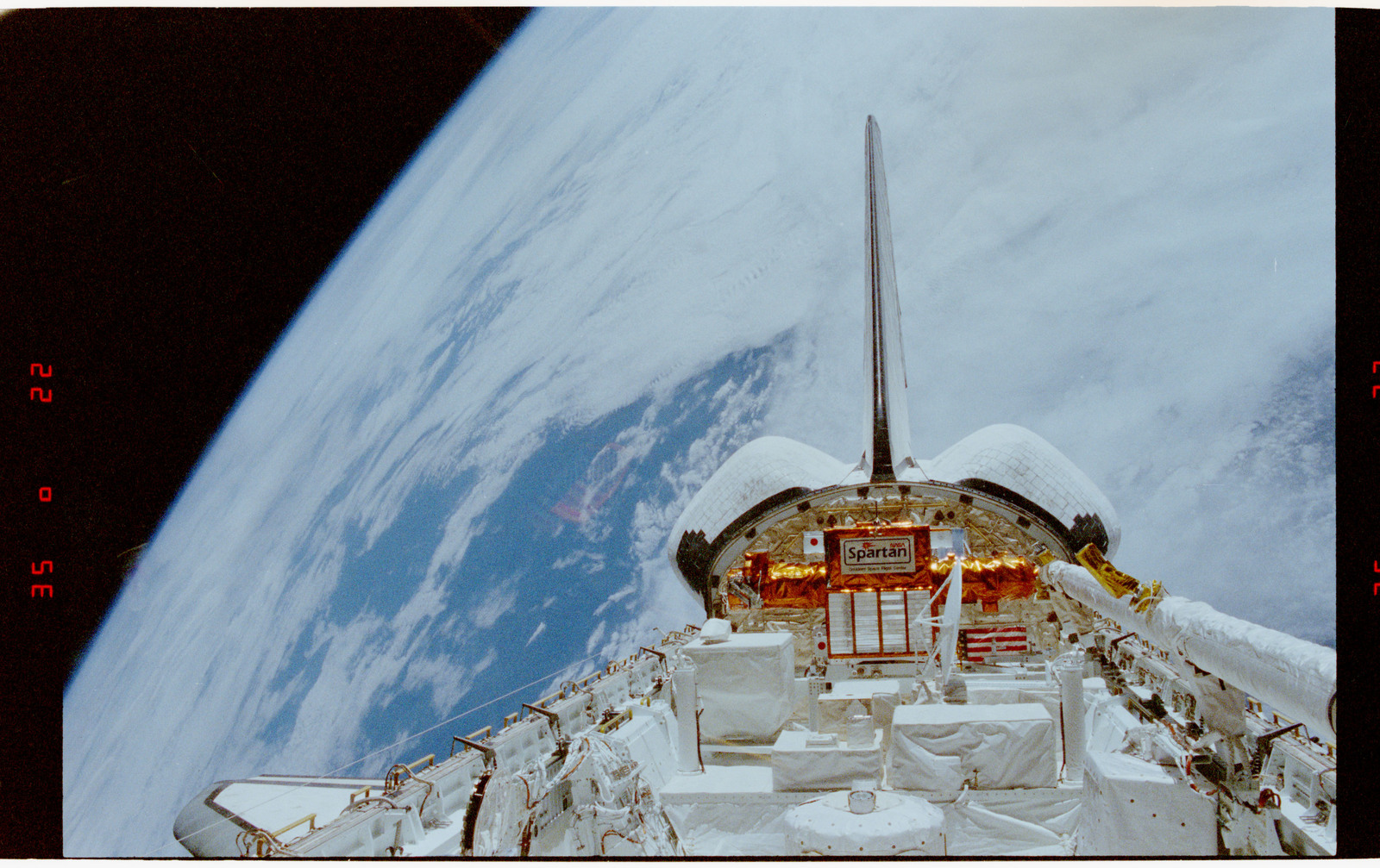STS056-24-031 - STS-056 - Earth observation view, orbiter tail Earth limb, clouds - location unknown.