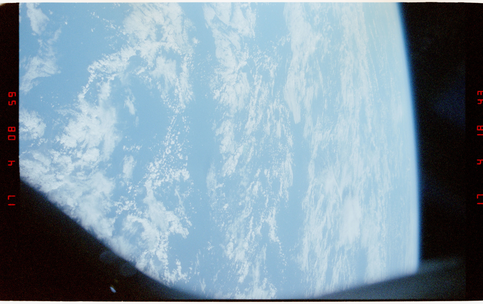STS056-27-026 - STS-056 - Earth limb, open ocean and clouds - location unknown.