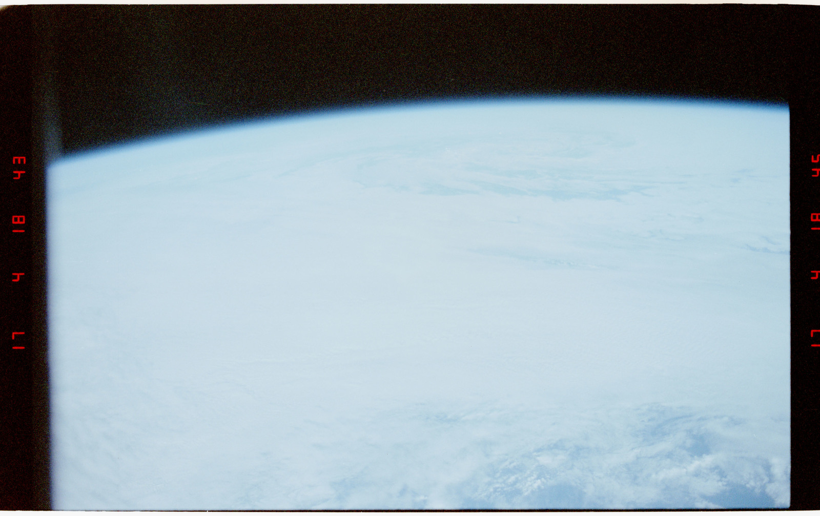 STS056-27-027 - STS-056 - Earth limb, open ocean, typhoon and clouds - location unknown.