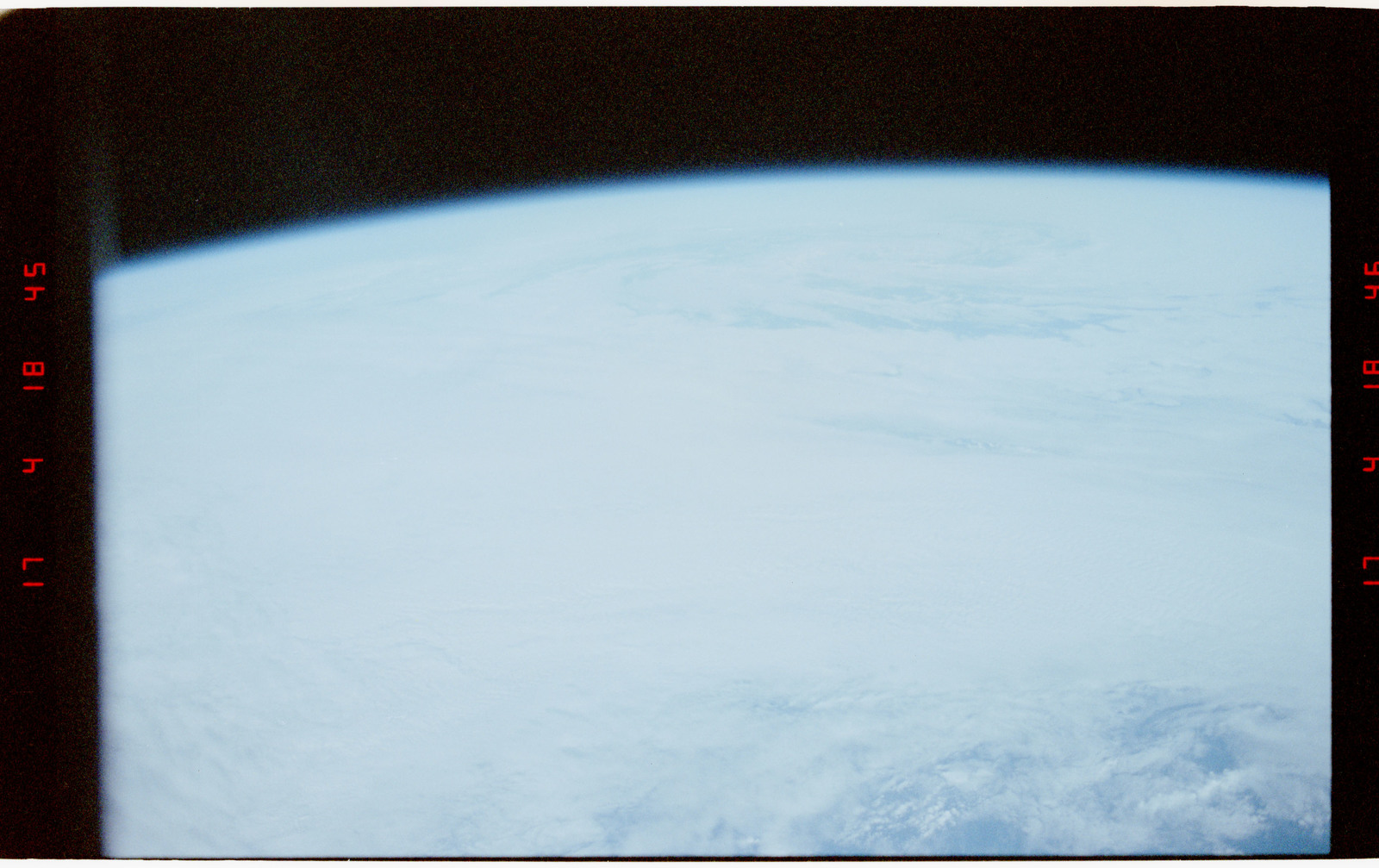 STS056-27-028 - STS-056 - Earth limb, open ocean, typhoon and clouds - location unknown.