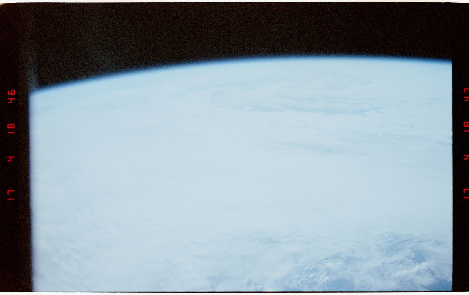 STS056-27-029 - STS-056 - Earth limb, open ocean, typhoon and clouds - location unknown.