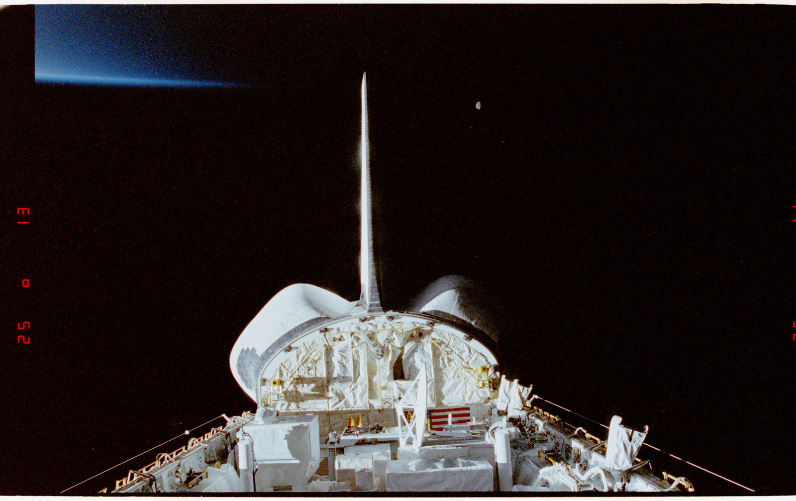 STS056-28-018 - STS-056 - Views of the payload bay, Earth limb with day/night terminator, and moon.
