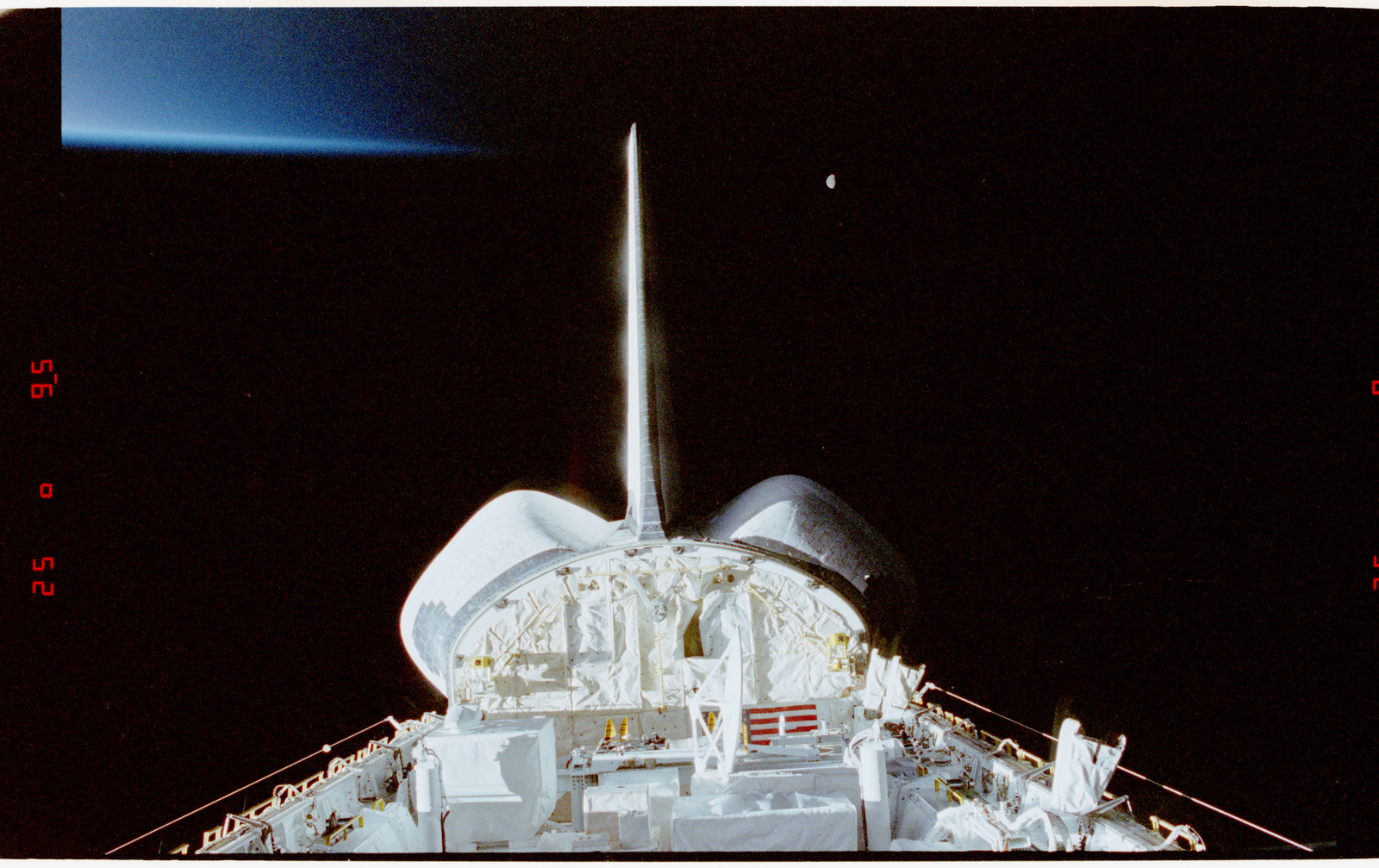STS056-28-020 - STS-056 - Views of the payload bay, Earth limb with day/night terminator, and moon.
