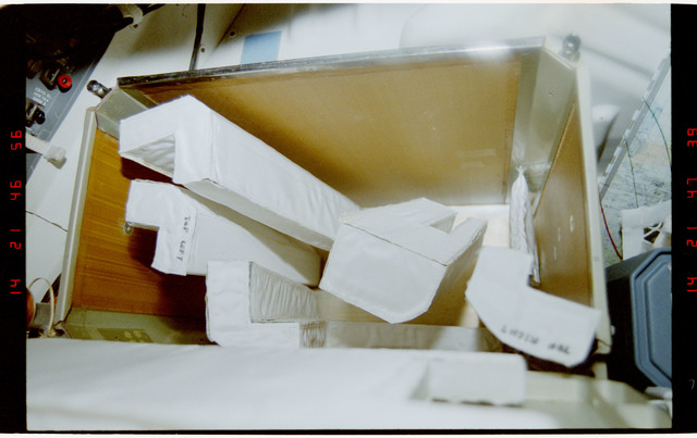 STS056-32-029 - STS-056 - Several long pieces of ``L`` shaped corner padding seen in a middeck container.