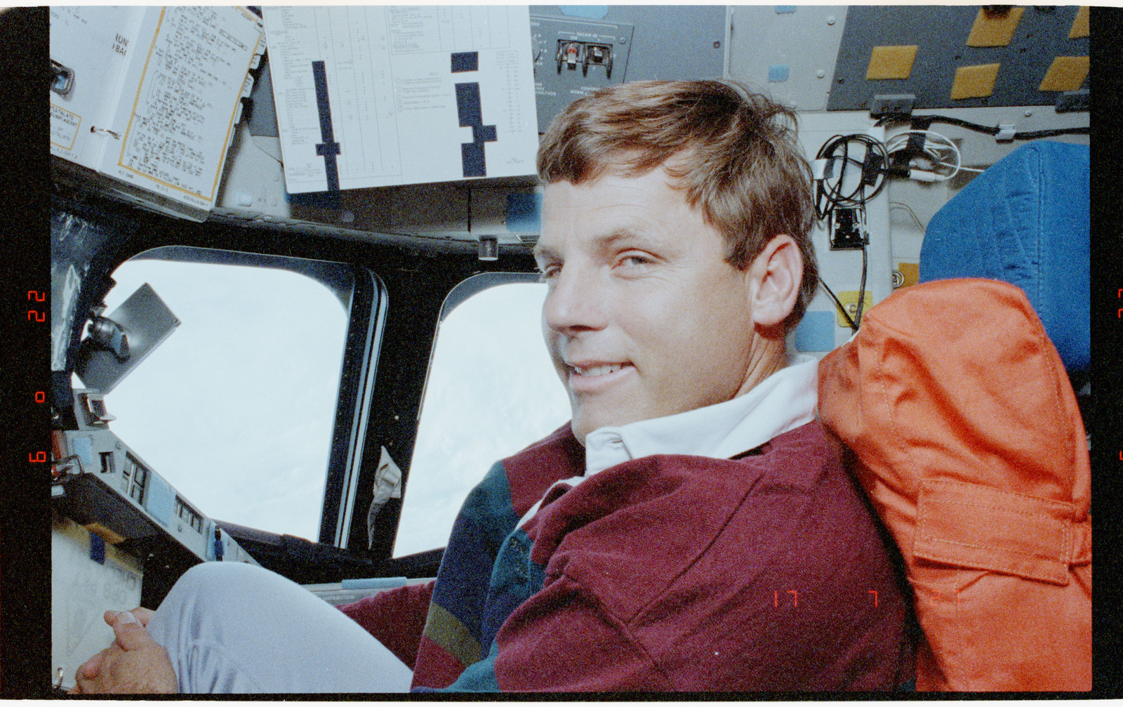 STS056-39-021 - STS-056 - Candid views of a crewmember in the fwd flight deck, Earth in background.