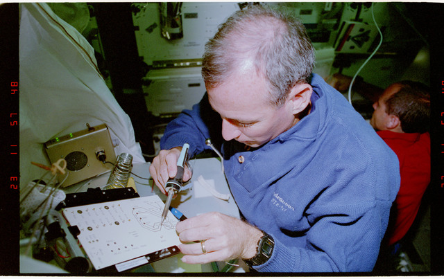 STS057-231-002 - STS-057 - Crewmember in the SPACEHAB at work on physical stability and dexterity exp.